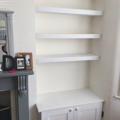 Floating shelves and cupboard